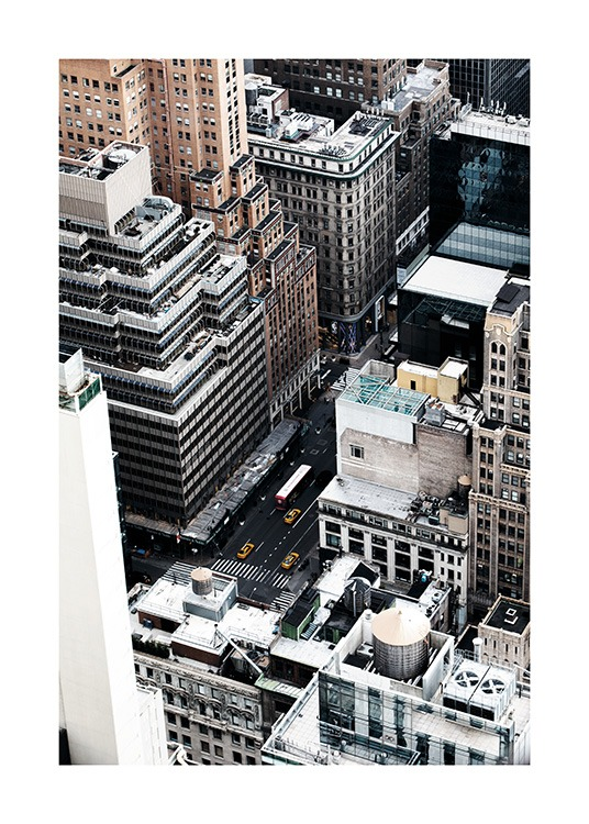 - Great aerial shot showing the skyscrapers and a street with some taxis in New York.