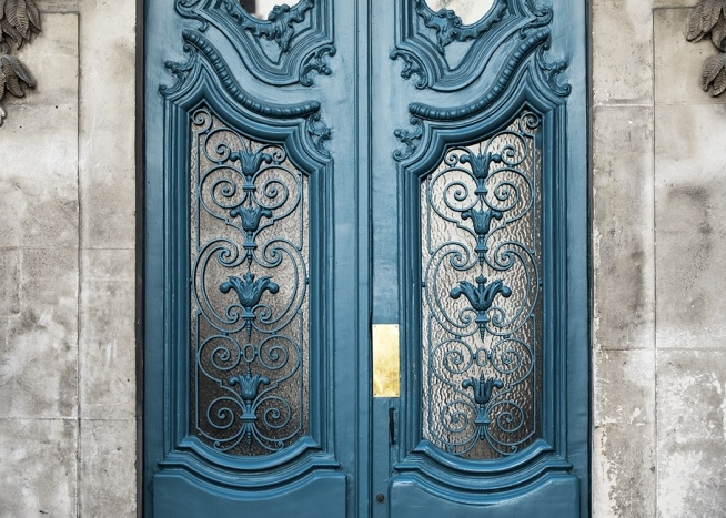 - Detailed shot of a blue front door in Paris beautifully decorated.