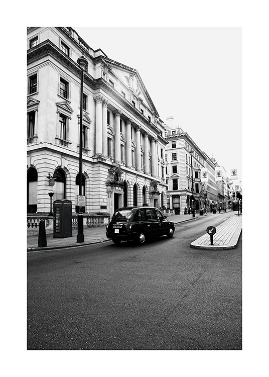 - Black and white photo poster of a London taxi driving on the left.