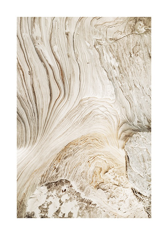 – Photograph of a beige cliff with a swirling, abstract pattern