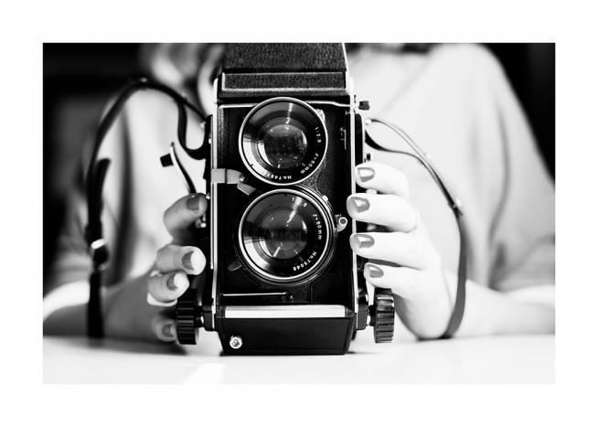 – Black and white photograph of an analog vintage camera with two lenses