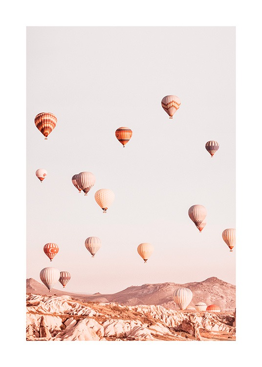 – Photograph of a mountain landscape with air balloons flying over the mountains
