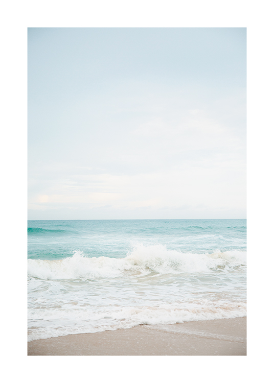 – Photograph of sea foam and a turquoise ocean with a light blue sky in the background