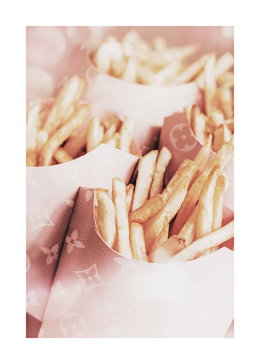– Photograph of french fries in pink Louis Vuitton boxes