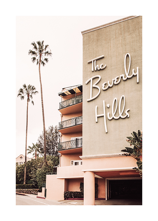 – Photograph of a hotel building with the sign