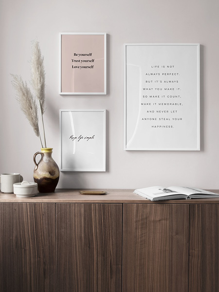 Modern text posters. Three prints with quotes and sayings framed on a wall.